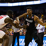 15 March 2018: San Diego State Aztecs forward Malik Pope (21) tries to drive the ball along the baseline while being defended by Houston Cougars forward Nura Zanna (13) in the first half. The San Diego State Aztecs got knocked out in the first round by Houston on a last second layup to lose 67-65  at Intrust Bank Arena in Wichita, Kansas.