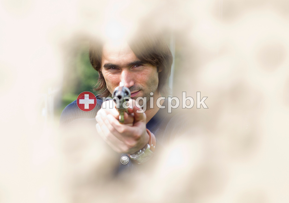 FC St.Gallen soccer player Sandro CALABRO of the Netherlands poses with a revolver while targeting during a photo session in St.Gallen, Switzerland, Wednesday, Sept. 29, 2010. (Photo by Patrick B. Kraemer / MAGICPBK)
