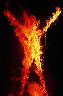 The Burningman on fire..The Burningman festival on the playa near Black Rock in NE Nevada.
