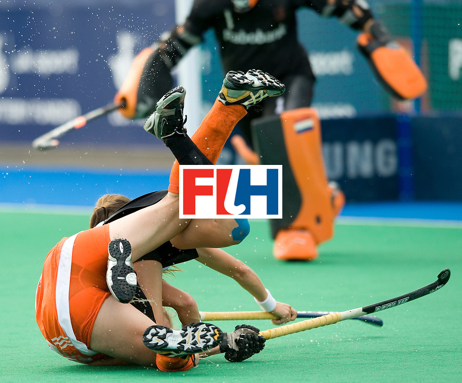 Argentina's  Carla Rebecchi crashes with Netherlands' Johanna Shopmann during their Women's Champions Trophy Final at Highfields, Beeston, Nottingham, 18th July 2010.