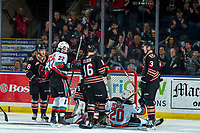KELOWNA, BC - FEBRUARY 17: Dillon Hamaliuk #22 raises his arms to celebrate a goal by Matthew Wedman #20 of the Kelowna Rockets after colliding into the net of Brayden Peters #35 of the Calgary Hitmen during second period at Prospera Place on February 17, 2020 in Kelowna, Canada. (Photo by Marissa Baecker/Shoot the Breeze)