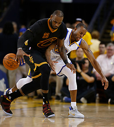 The Golden State Warriors' Andre Iguodala, right, plays tough defense against the Cleveland Cavaliers' LeBron James (23) in the second quarter of Game 5 of the NBA Finals at Oracle Arena in Oakland, Calif., on Monday, June 12, 2017. (Photo by Nhat V. Meyer/Bay Area News Group/TNS) *** Please Use Credit from Credit Field ***