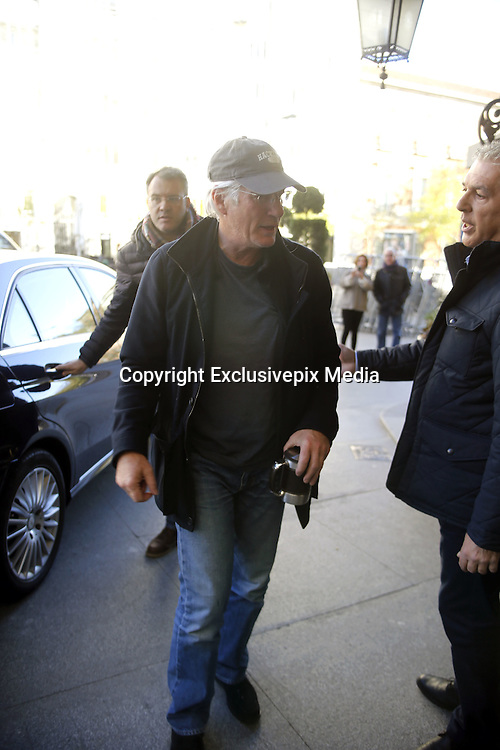 MADRID, SPAIN, 2015, NOVEMBER 23 <br /> <br /> Richard Gere arrives at Madrid Airport where he is greeted by Girlfriend Alejandra Silva<br /> <br /> Richard Gere arrives at the airport of Madrid, to present today, the film Time Out of Mind, directed by Oren Moverman. His Spanish girlfriend, Alejandra Silva, came to pick him up. Alejandra Silva wore a wrist<br /> &copy;Exclusivepix Media