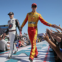 Kevin Harvick (L) and Joey Logano are seen during driver introductions for the 60th Annual NASCAR Daytona 500 auto race at Daytona International Speedway on Sunday, February 18, 2018 in Daytona Beach, Florida.  (Alex Menendez via AP)