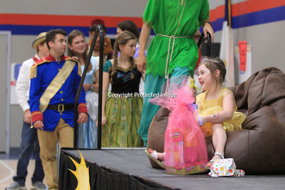 """Dressed as Belle, from the Disney movie """"Beauty and the Beast"""", Azie Leathers, of Tremont, receives some gifts as her Make-A-Wish dreams came true with a trip to Disney World Wednesday morning at TCPS in Tupelo."""