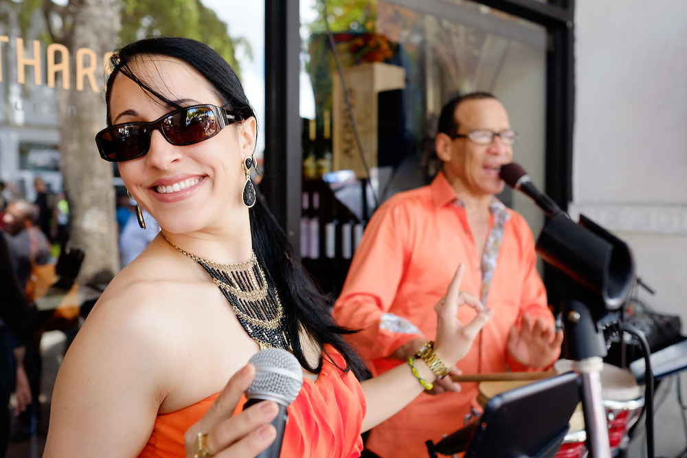 MIAMI - MARCH 9, 2014: Portrait of woman singing and dancing during the 37th Calle Ocho festival, an annual event that takes place over Eight Street in Little Havana featuring plenty of music, food, and  it is the biggest party in town that celebrates hispanic heritage.
