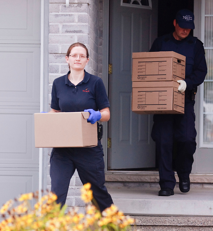 London, Ontario ---10-08-26--- RCMP investigators remove evidence from a home in London, Ontario August 26, 2010 where they arrested a man in a Terrorism related investigation.<br /> GEOFF ROBINS The Globe and Mail