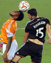 Houston Dynamo midfielder Giles Barnes, left, heads the ball as D.C. United's Steven Birnbaum defends during the second half of an MLS soccer game, Sunday, August 3, 2014, at BBVA Compass Stadium in Houston. (Photo: Eric Christian Smith/For the Chronicle)