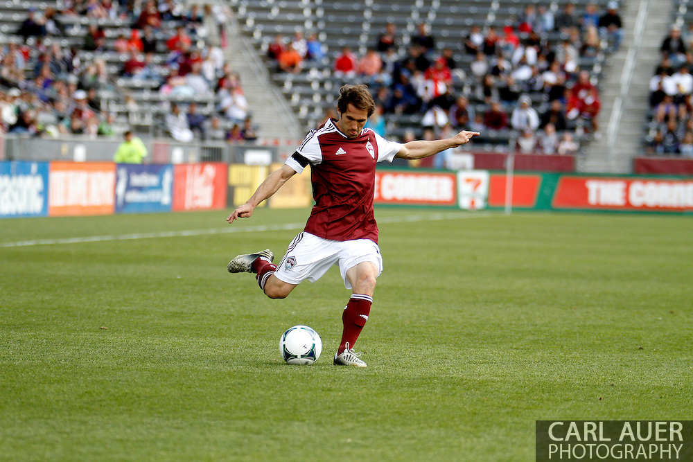 April 20th, 2013 Commerce City, CO - Colorado Rapids midfielder Brian Mullan (11) attempts to cross the ball in front of the goal n the first half of action of the MLS match between the Seattle Sounders FC and the Colorado Rapids at Dick's Sporting Goods Park in Commerce City, CO