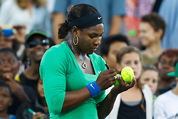 July 26, 2011; Stanford, CA, USA;  Serena Williams (USA) signs autographs after her match against Anastasia Rodionova (AUS), not pictured, during the first round of the Bank of the West Classic women's tennis tournament at the Taube Family Tennis Stadium. Williams defeated Rodionova 6-0, 6-0.