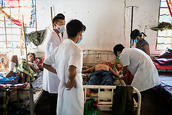 Laiza 20160915<br /> Lazum Htoi San, a K.I.A. rebell injured in a Burmese army shelling of Tsin Yu Bum, a mountain top with a frontline outpost, getting emergency treatment at the army hospital in Laiza, Kachin State, Myanmar.<br /> Photo: Vilhelm Stokstad / Kontinent