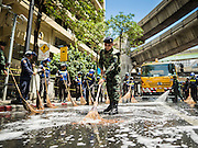 18 AUGUST 2015 - BANGKOK, THAILAND: Thai soldiers clean the street in front of Erawan Shrine Tuesday. The street was covered in debris after a bomb went off in the shrine. An explosion at Erawan Shrine, a popular tourist attraction and important religious shrine in the heart of the Bangkok shopping district, killed at least 20 people and injured more than 120 others, including foreign tourists, during the Monday evening rush hour. Twelve of the dead were killed at the scene. Thai police said an Improvised Explosive Device (IED) was detonated at 18.55. Police said the bomb was made of more than six pounds of explosives stuffed in a pipe and wrapped with white cloth. Its destructive radius was estimated at 100 meters.    PHOTO BY JACK KURTZ