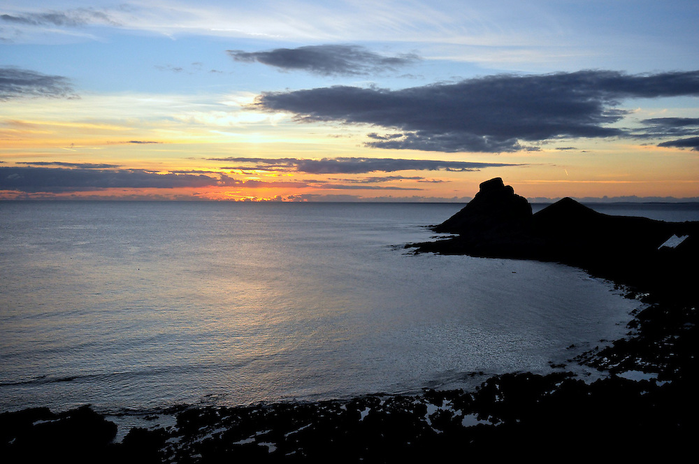 Sunset in Worms Head at the Gower Peninsula. It is possible to spend the night in the island as long as you warn the coast guards before you cross. Otherwise you risk being surprised by the rescue helicopter in the middle of the night thinking you are trapped in the high tide.