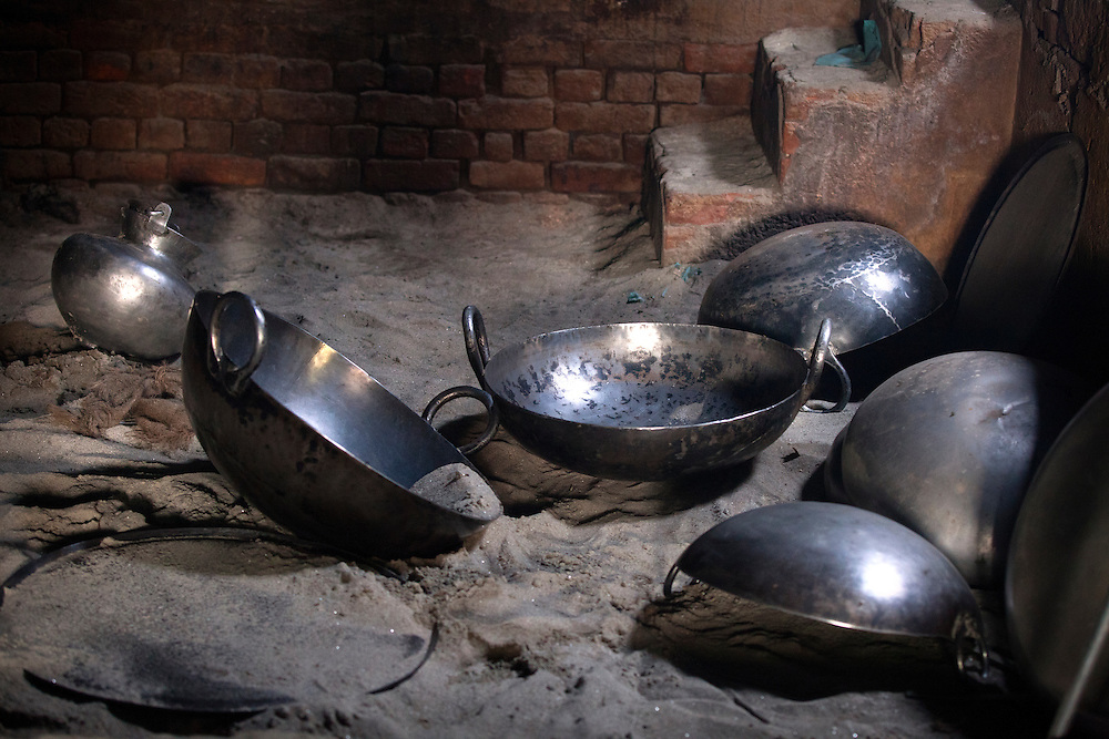 Pots used in a Sikh kitchen are waiting to be cleaned.