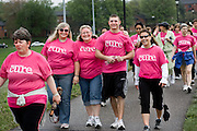Cindy Skeggs, center, puts her arms around her kids Marilynn, left, and patrick during the Walk for a Cure Saturday on the Ohio University Campus.