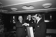 06/04/1966<br /> 04/06/1966<br /> 06 April 1966<br /> Captain John Williams retires as Master of B &amp; I ship the M.V. &quot;Munster&quot;. Captain Williams was presented with a tape recorder by the Masters, Officers and staff of all the B &amp; I ships. Picture shows Captain Gerald Barry, (right)Master of the M.V. &quot;Leinster&quot; making the presentation to Captain Williams. Captain Matthew Hollywood (centre) was the new Master of the M.V. &quot;Munster&quot;.