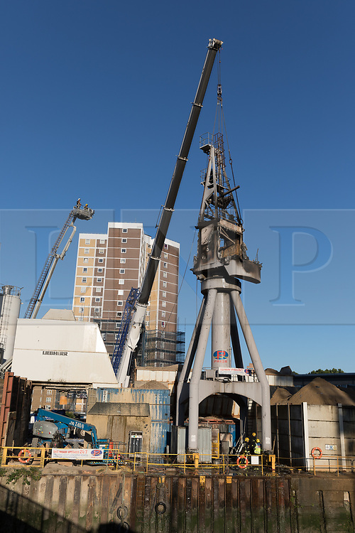 © Licensed to London News Pictures. 30/06/2018. London, UK.  The scene in Creek Road, Greenwich where a crane caught fire this evening.  Photo credit: Vickie Flores/LNP