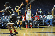 """Ole Miss' Erika Sisk (5) makes a three pointer vs. Christian Brothers in an exhibition basketball game at the C.M. """"Tad"""" Smith Coliseum in Oxford, Miss. on Friday, November 7, 2014. (AP Photo/Oxford Eagle, Bruce Newman)"""