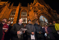 "© Licensed to London News Pictures. 17/11/2015. Bristol, UK.  Vigil for the victims of the Paris terrorist attacks at Bristol Cathedral.  Religious and community leaders including Peter Brill from Salaam Shalom (speaking at left) and Arif Khan (centre) chair of the Council of Mosques. The Muslim community in Bristol organised a candle-lit vigil for all faiths and backgrounds at Bristol Cathedral to show solidarity with the victims of the Paris attacks which are claimed by IS (Islamic State).  The management and Imaam's of Bristol's Easton Jamia Masjid, Bristol's biggest mosque, released a statement saying they have been shocked and saddened by the attacks on innocent people in France. ""We strongly condemn the terrorist atrocities in France, these sickening crimes are an attack against all of humanity.  As a local Muslim place of worship we send our condolences from our local community and congregation to the people of France.  During this very dark hour they will see compassion and solidarity from around the world"".  Photo credit : Simon Chapman/LNP"
