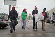 August 16, 2014- Ferguson, Mo.- A group of young people walk from business to business, helping clean up debris from Friday night's looting. 8/15/2014 Photo by Dave Gershgorn/ NYCity Photo Wire