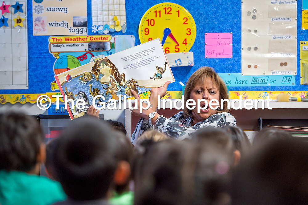 081313       Cable Hoover<br /> <br /> New Mexico Gov. Susana Martinez reads a storybooks to a group of first-graders during a visit to Jefferson Elementary School in Gallup Tuesday.