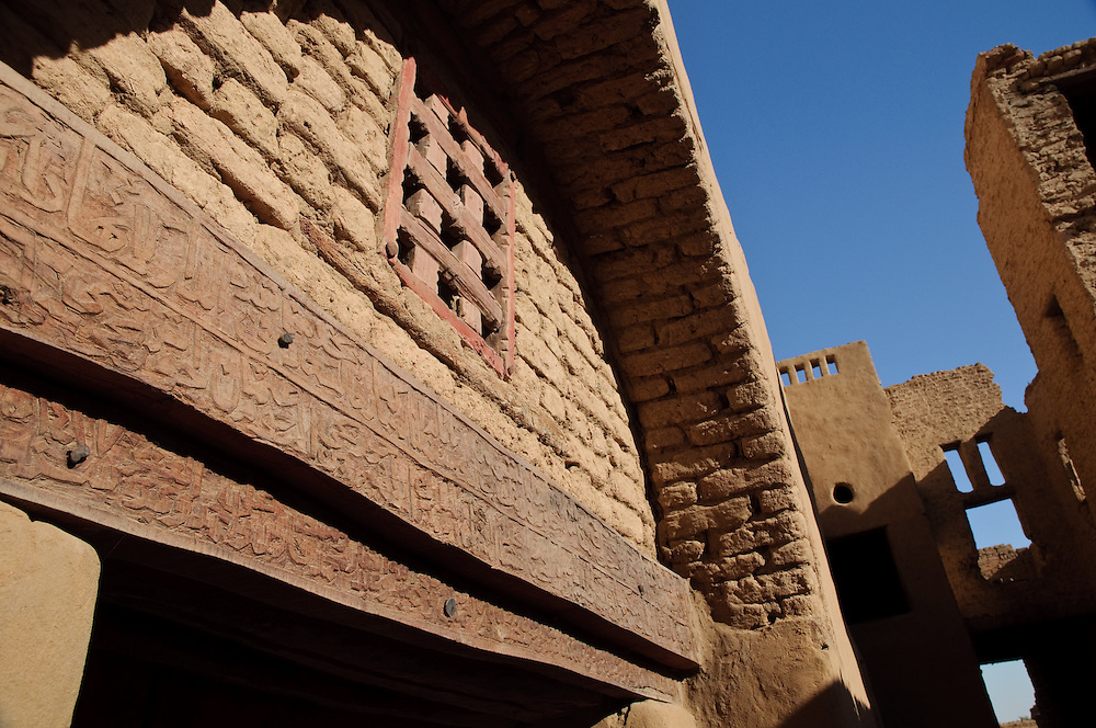 A doorway with a carved lintel from Ottoman times, in Al Qasr, Dakhla Oasis