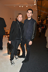 EVA CAVALLI and her son ROBERT CAVALLI at the PAD London 2015 VIP evening held in the PAD Pavilion, Berkeley Square, London on 12th October 2015.