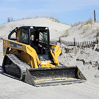 John Deere frontloader at rest from clearing sand from boardwalk, Lavalette, New Jersey