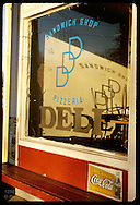 Late afternoon sun pours into front window of the DDD Deli in the town of Kirkwood. Missouri