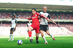 LIVERPOOL, ENGLAND - Sunday, April 11, 2010: Liverpool's Maximiliano Ruben Maxi Rodriguez and Fulham's Paul Konchesky during the Premiership match at Anfield. (Photo by: David Rawcliffe/Propaganda)