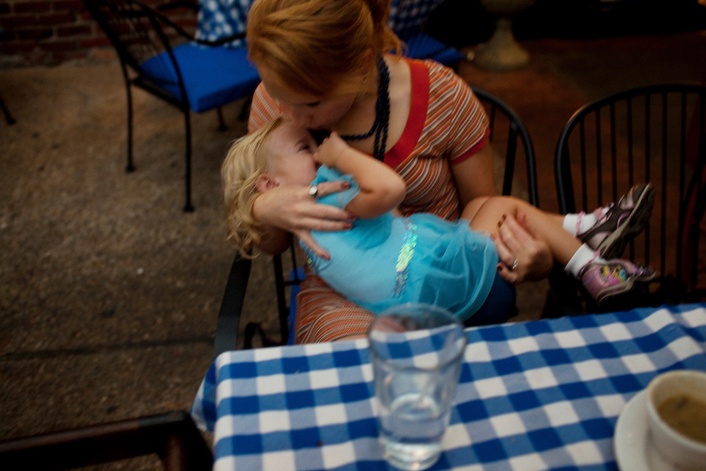 Melissa Eich, 23, kisses and rocks her daughter Madelyn Avery Eich, 2, who is dressed in a blue princess dress, at The Bier Garden in Portsmouth, Virginia on Saturday, September 18, 2010.