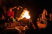 People around a fire at Middle East Tek, Wadi Rum, Jordan, 2008