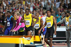 London, August 12 2017 . Usai Bolt crosses the finish line  assisted by his teammates after suffering an injury to his hamstring as he ran the final 100m in the men's 4x 100m relay  on day nine of the IAAF London 2017 world Championships at the London Stadium. © Paul Davey.
