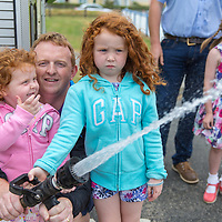 Ella and Cara Fitzpatrick from Sixmilebridge with their Dad sqwerting  the Firemans hose during the Kilkee by the Sea Festival 2018