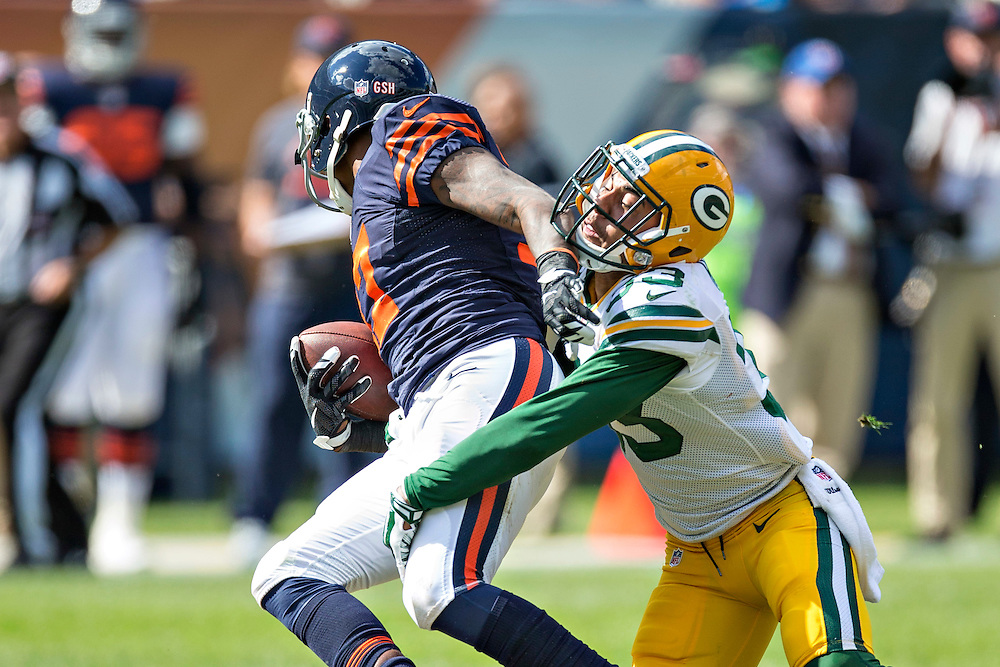 CHICAGO, IL - SEPTEMBER 13:  Micah Hyde #33 of the Green Bay Packers tackles Alshon Jeffery #17 of the Chicago Bears at Soldier Field on September 13, 2015 in Chicago, Illinois.  The Packers defeated the Bears 31-23.  (Photo by Wesley Hitt/Getty Images) *** Local Caption *** Micah Hyde; Alshon Jeffery
