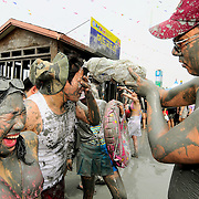 People play with mud at the 11th Annual Mud Festival in Boryeong, South Korea, 2008.
