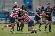 Iliess Macani (Bradford Bulls) is tackled by Adam Neal (Oldham Roughyeds) during the Kingstone Press Championship match between Oldham Roughyeds and Bradford Bulls at Bower Fold, Oldham, United Kingdom on 2 April 2017. Photo by Mark P Doherty.