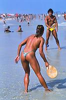 Rio de Janeiro, Brazil --- Sunbathers on Rio de Janeiro Beach --- Image by © Owen Franken