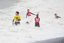 © Licenced to London News Pictures.Aberystwyth Wales UK, Sunday 16 September 2018. UK Weather:  Young members of the local life saving club still train exuberantly in the waves on a wet and windy September Sunday afternoon. The west of the UK is bracing itself for the impact of Storm Helene, which is predicted to strike overnight on Monday, with winds gusting up to 70mph in exposed areas, , with the risk of danger to life from flying debris . Photo © Keith Morris // LNP
