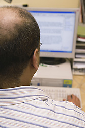 Man using a computer,