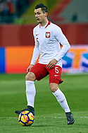 Chorzow, Poland - 2018 March 27: Krzysztof Maczynski from Poland controls the ball while Poland v South Korea International Friendly Soccer match at Stadion Slaski on March 27, 2018 in Chorzow, Poland.<br /> <br /> Mandatory credit:<br /> Photo by © Adam Nurkiewicz / Mediasport<br /> <br /> Adam Nurkiewicz declares that he has no rights to the image of people at the photographs of his authorship.<br /> <br /> Picture also available in RAW (NEF) or TIFF format on special request.<br /> <br /> Any editorial, commercial or promotional use requires written permission from the author of image.