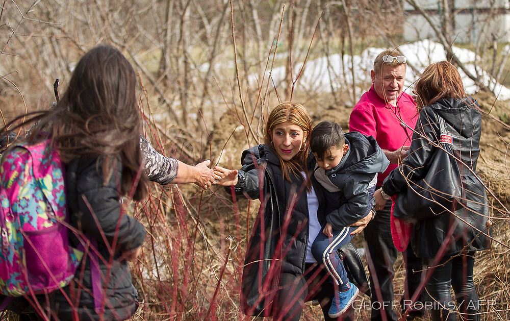 An extended family of 8 people from Colombia illegally cross the border into Canada near Hemmingford Quebec, February 25 2017.