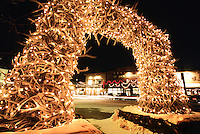 Holiday lights decorate an antler arch on the Town Square of Jackson, Wyoming.