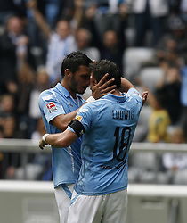 Alexander Ludwig and Mathieu Beda share an intimate moment after scoring a goal during the Bundesliga match between TSV 1860 Munchen and SpVgg Greuther Forth on the 12th September 2009.