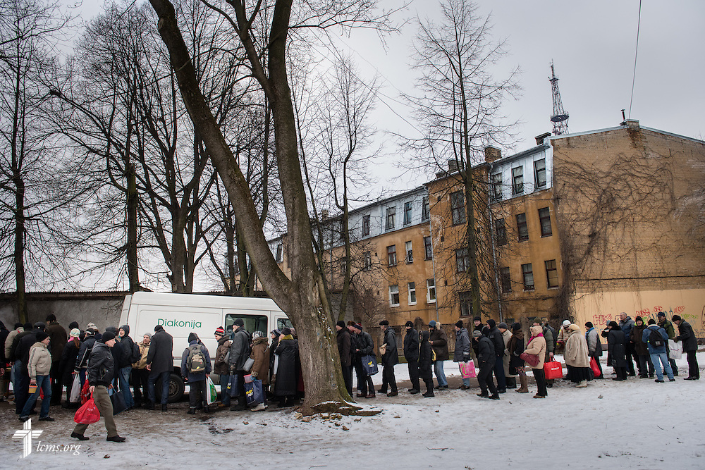 A line of area residents and homeless forms as Ilze Juhnevia (not pictured) with the Diaconia Center of The Evangelical Lutheran Church of Latvia, doles out hot soup  on Thursday, Feb. 5, 2015, in Riga, Latvia. LCMS Communications/Erik M. Lunsford