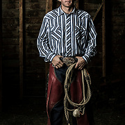 UVU Rodeo team member Tag Elliott pose for photos in a barn on the farm of Robert Taylor in Provo, Utah Tuesday April 9, 2013. (August Miller)