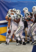 New York Jets tight end Dustin Keller (81) celebrates with Jets wide receiver Jerricho Cotchery (89) and other teammates after Keller catches a two yard touchdown pass in the corner of the end zone that gives the Jets a 10-7 lead in the fourth quarter of the AFC Divisional Playoff game against the San Diego Chargers, January 17, 2010 in San Diego, California. The Jets won the game 17-14. ©Paul Anthony Spinelli
