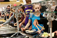 Rachel Gowey, 18, of Urbandale grabs a sandwich from the lunch line Thursday, May 12, 2016, at Johnston High School in Johnston. Gowey said she wanted to finish out her public high school education, even though most elite gymnasts chose to home school because of the demands of gymnastics practice.