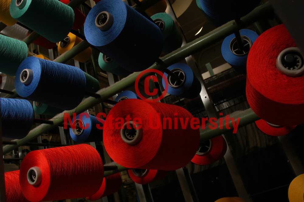 Yarn on spools waiting to be woven into fabric.                 PHOTO BY ROGER WINSTEAD