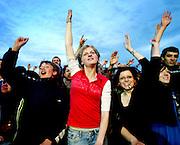 """Rostock   June 3, 2007 ..G8-Gipfel Heiligendamm: Tausende Globalisierungsgegner und Globalisierungskritiker feiern beim """"Move Against G8""""-Festival mit vielen Live-Bands und Vortr?gen am Stadthafen Rostock. Hier: Stimmung im Publikum, Abendhimmel...G8-Summit Heiligendamm: Thousands of protesters against the G8-Summit celebrate and listen to speeches at the city harbour in Rostock. Here: Celebrating audience, evening sky...20070608g8 ...[Inhaltsveraendernde Manipulation des Fotos nur nach ausdruecklicher Genehmigung des Fotografen. Vereinbarungen ueber Abtretung von Persoenlichkeitsrechten/Model Release der abgebildeten Person/Personen liegen nicht vor.]"""